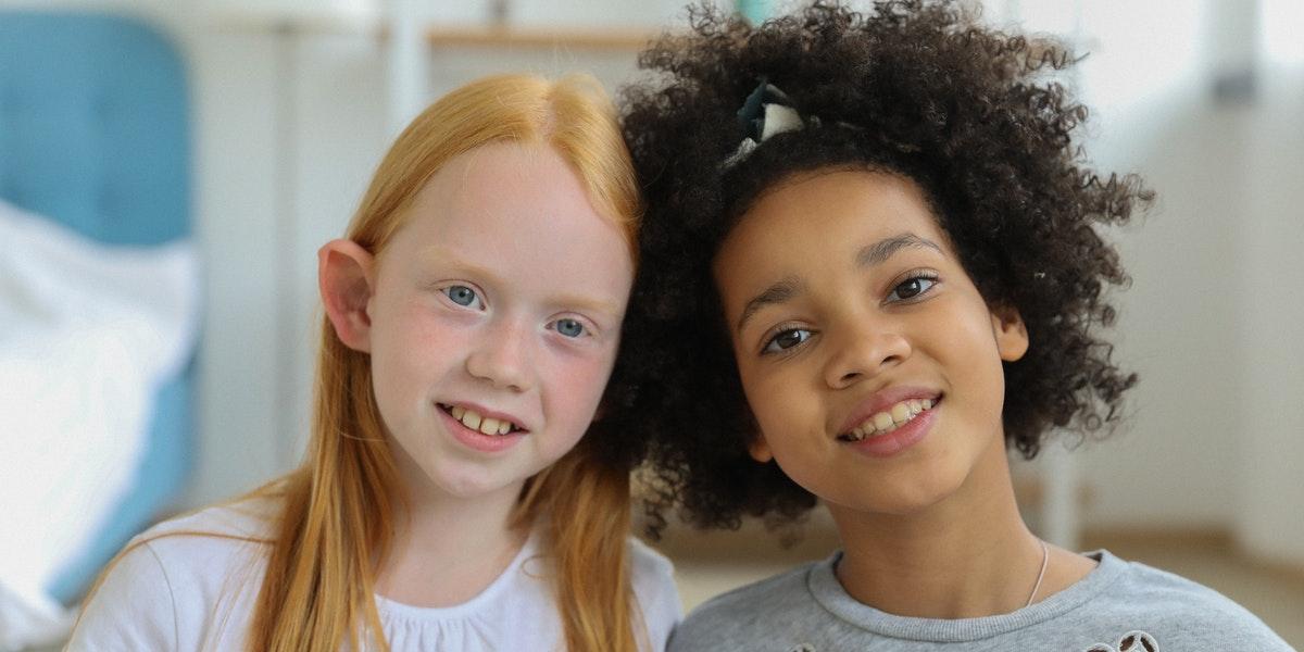 two girls touching heads