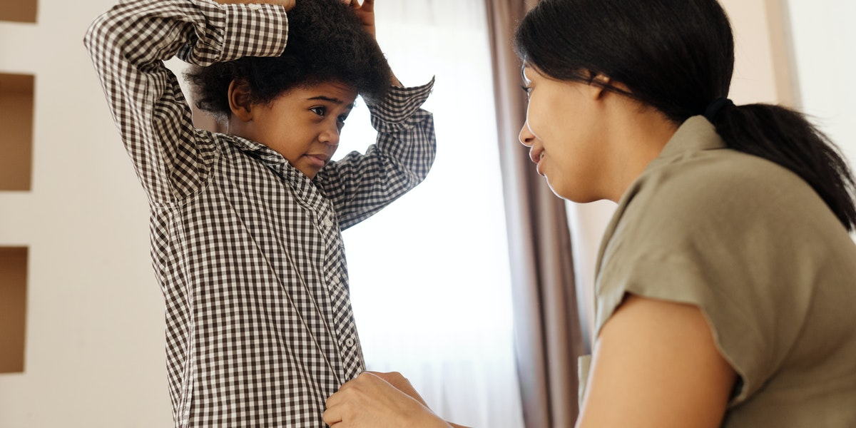 child brushing hair head lice