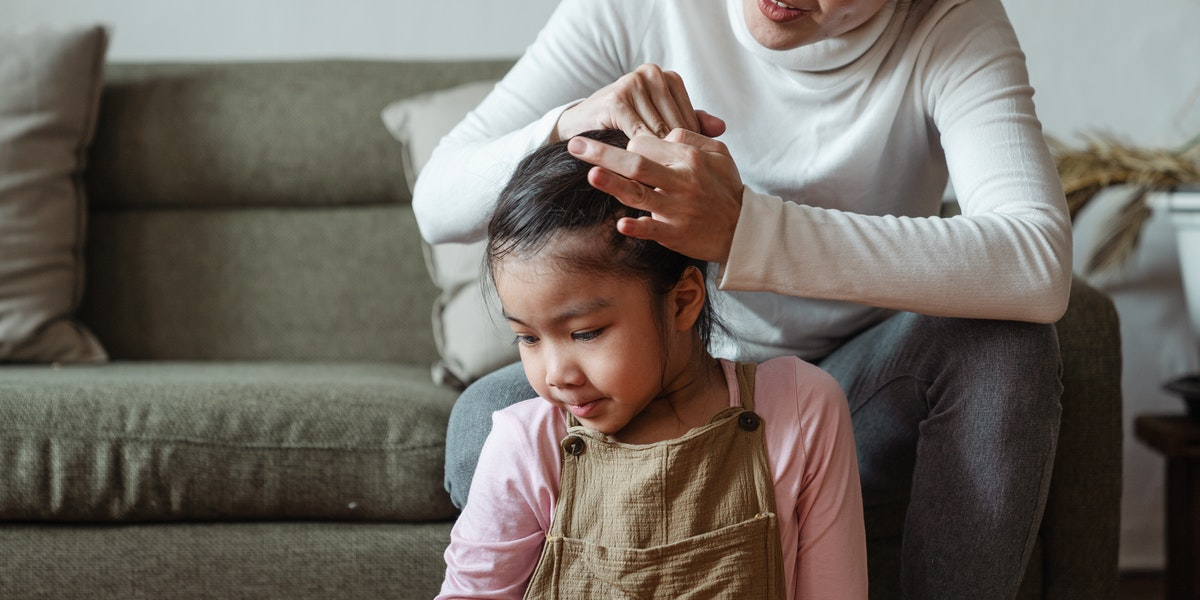little girl with head lice